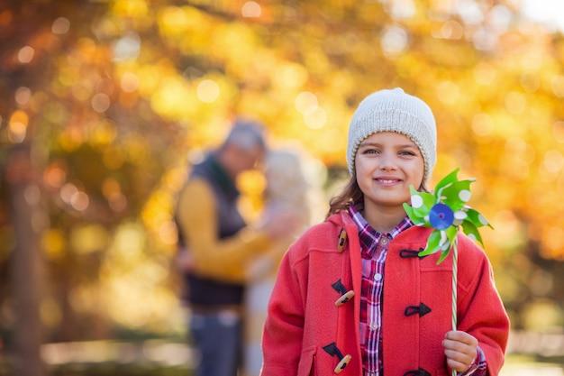 Portrait of smiling girl holding pinwheel toy