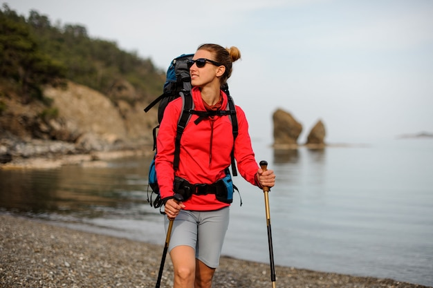 Portrait of smiling girl with hiking equipment