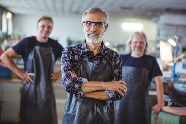 Portrait of smiling glassblowers