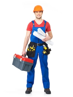 Portrait of smiling handyman with tools and paper isolated on white