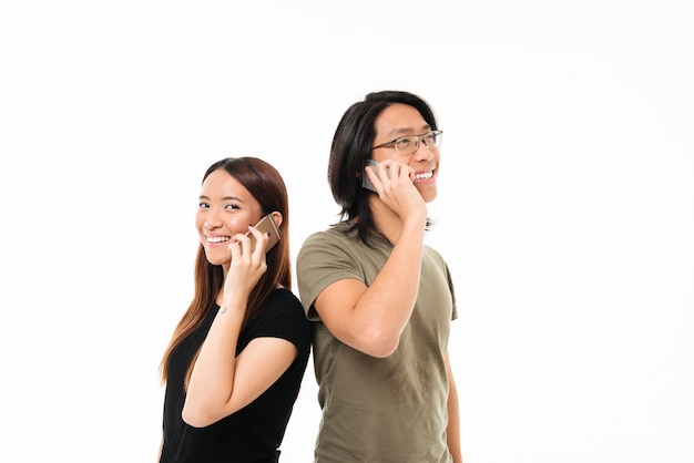 Portrait of a smiling happy asian couple talking