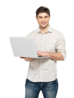 Portrait of smiling happy man with laptop  in casuals - isolated on white. concept communication.