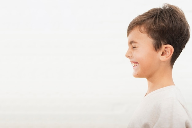 Portrait of smiling kid with copy space