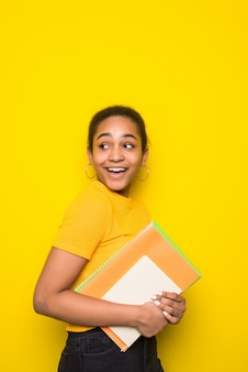Portrait of smiling latin young woman student .
