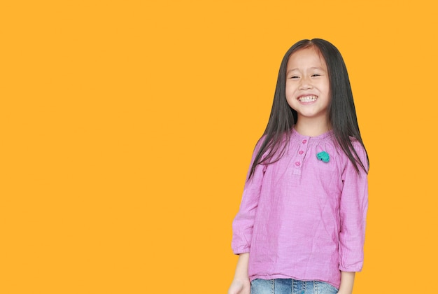 Portrait of smiling little asian child girl isolated