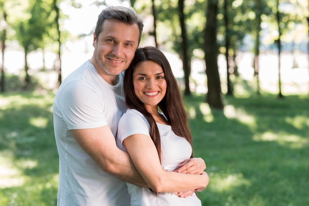 Portrait of smiling loving couple in park