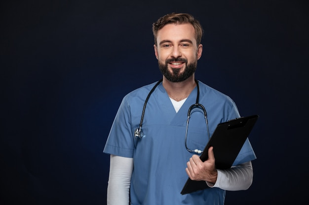 Portrait of a smiling male doctor dressed in uniform