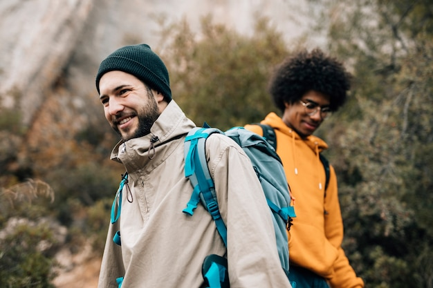 Portrait of a smiling male hiker hiking with his friend