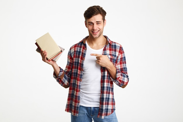 Portrait of a smiling male student holding books