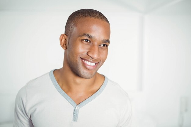 Portrait of smiling man standing and looking away