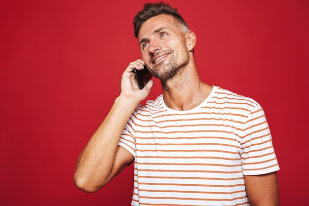 Portrait of a smiling man standing on red