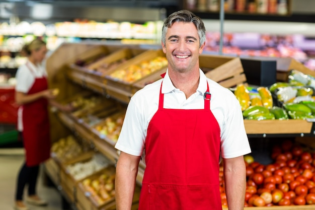 Portrait of smiling man wearing apron