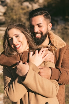 Portrait of smiling man and woman hugging