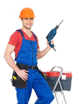 Portrait of smiling manual worker with tools isolated on white