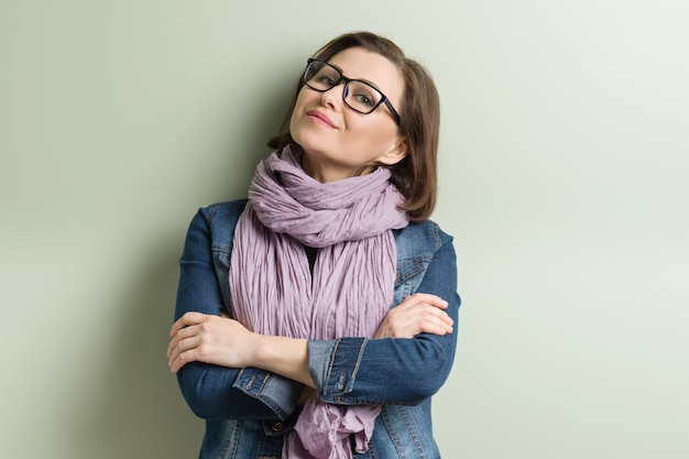 Portrait of smiling middle aged confident woman in glasses