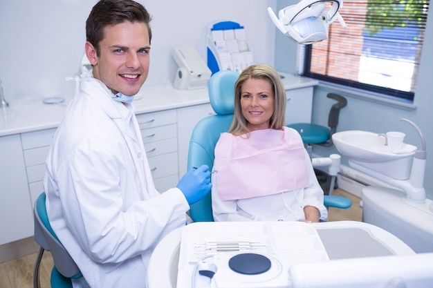 Portrait of smiling patient and dentist