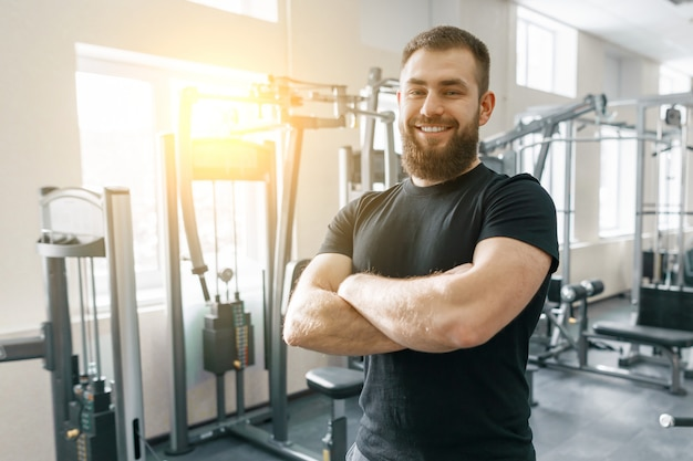 Portrait of smiling personal fitness trainer in gym