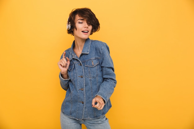Portrait of a smiling satisfied woman dressed in denim jacket