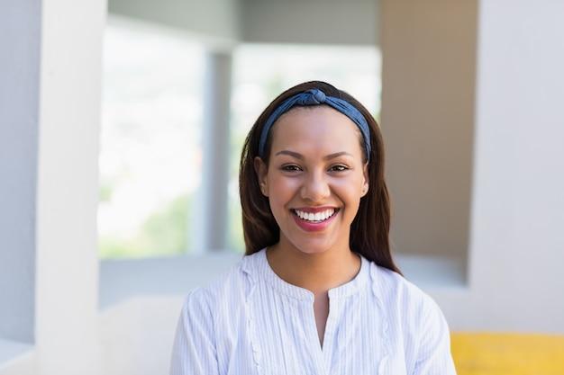 Portrait of smiling school teacher in classroom