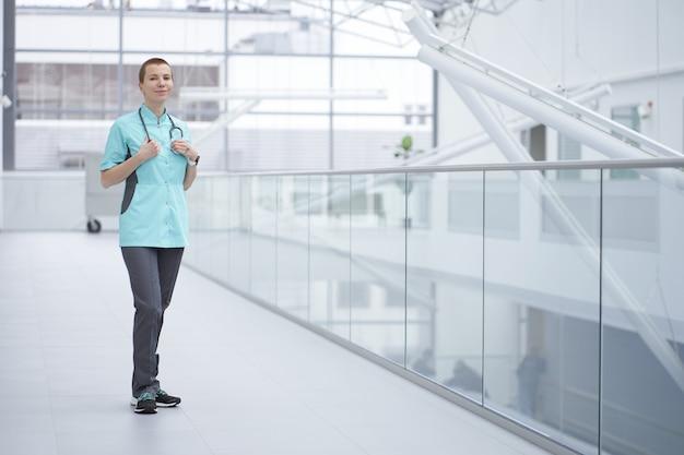 Portrait of smiling shortcut caucasian woman doctor, copy space