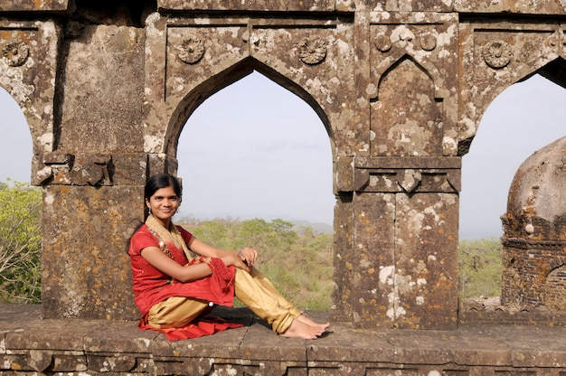 Portrait of smiling teenage girl in front of fort