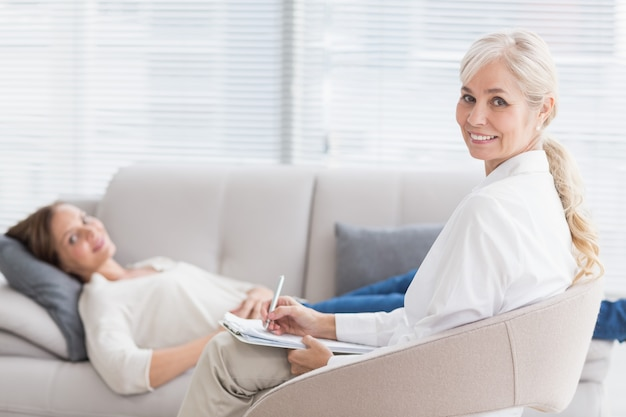 Portrait of smiling therapist with patient