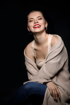 Portrait of smiling woman on black