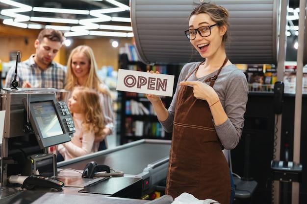 Portrait of smiling woman cashier