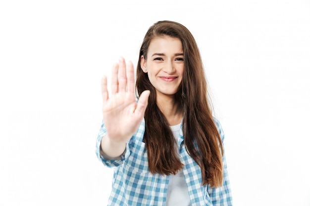 Portrait of a smiling woman giving high five to camera