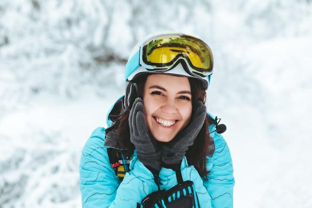 Portrait of smiling woman in ski equipment