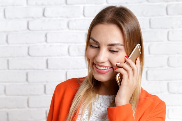 Portrait of a smiling woman using smartphone