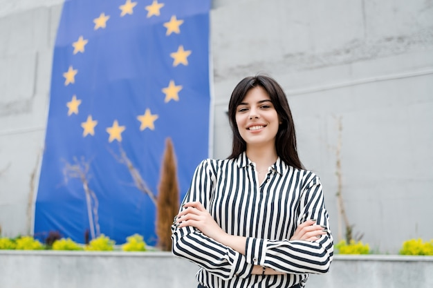 Portrait of a smiling woman with the european union flag on the