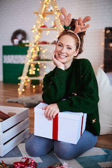 Portrait of smiling woman with reindeer antlers