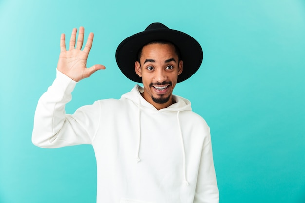 Portrait of a smiling young afro american man in hat