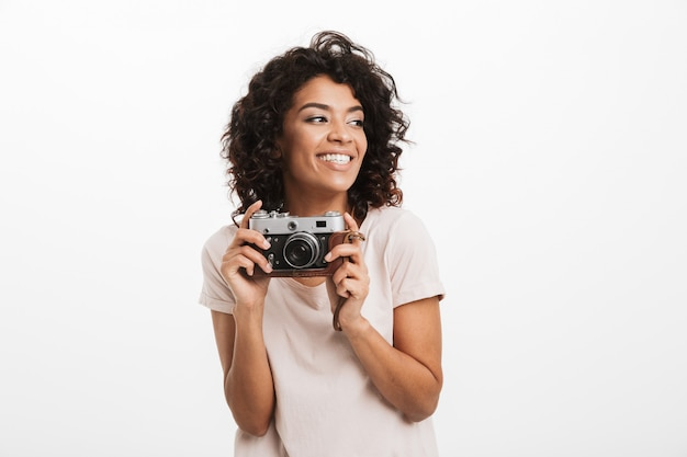 Portrait of a smiling young afro american woman with camera