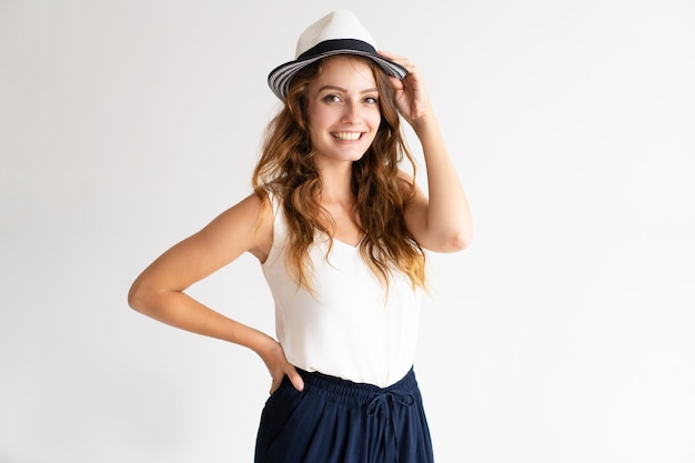 Portrait of smiling young beautiful girl posing in summer hat.
