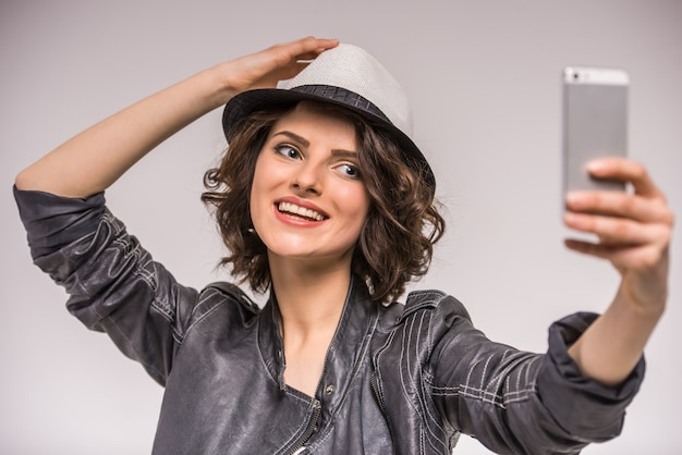 Portrait of smiling young beauty woman doing selfie.