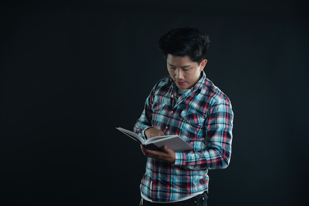 Portrait of smiling young college student with books