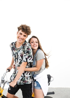 Portrait of smiling young couple enjoying the bicycle ride