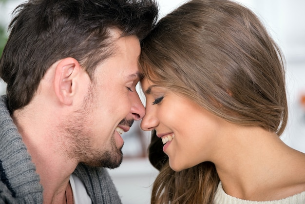Portrait of smiling young couple spend time together.
