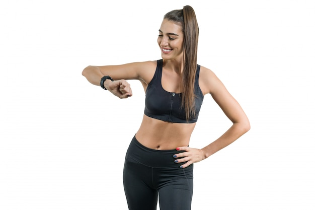 Portrait of smiling young female looking at wrist watch
