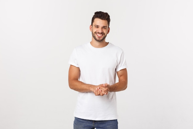 Portrait of smiling young man in a white t-shirt isolated on white .