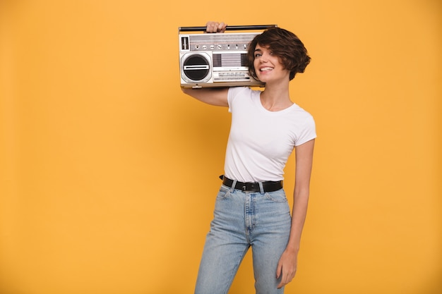 Portrait of a smiling young woman holding record player