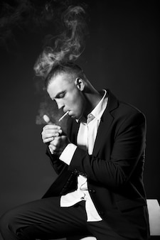 Portrait of a smoking businessman in a suit