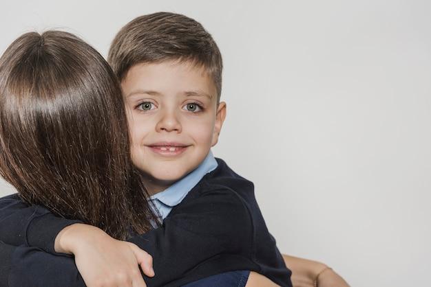 Portrait of son hugging mother
