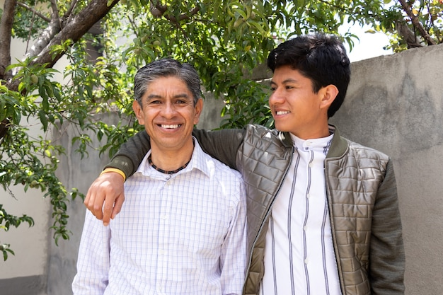 Portrait of son looking at his father while both are smiling