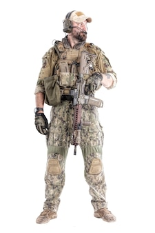 Portrait of special forces soldier in field uniforms with weapons, portrait isolated on white