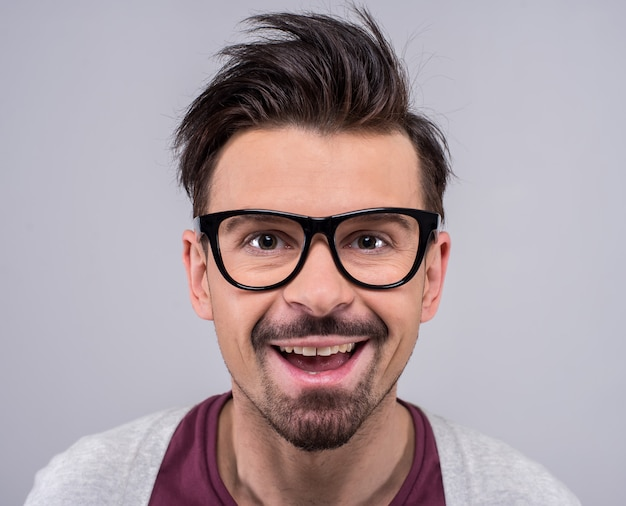 Portrait of spectacled man is looking at the camera.