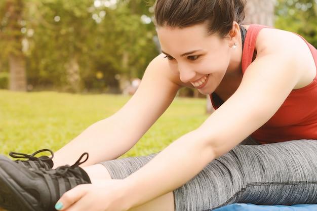 Portrait of sport woman streching legs