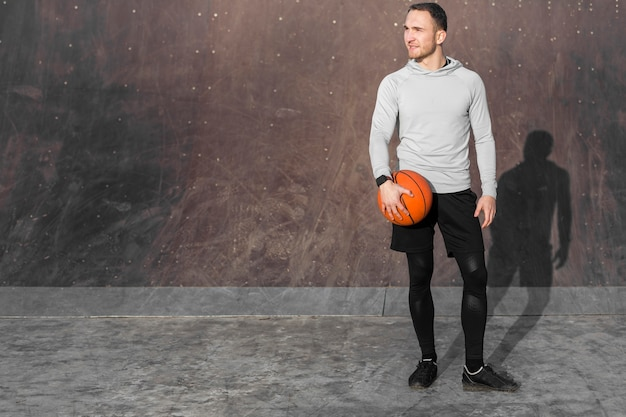 Portrait of sporty man with a basketball